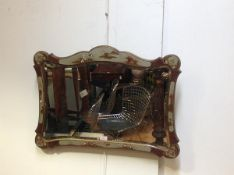 A 1920's silver lacquer Chinoiserie wall mirror, probably Hille of London, the shaped rectangular