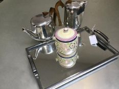 A two piece Piquot ware set comprising teapot and hot water jug, an Art Deco chromium plated