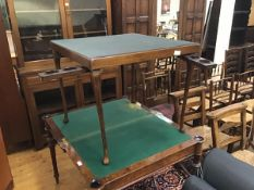 A vono style folding bridge table, with patented fold out cup holders and bakelite ashtrays, the