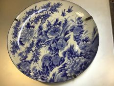 A Japanese large porcelain plaque decorated with blue and white pheasant and birds (d.62cm)