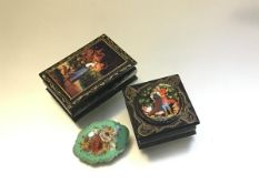 Two Russian treen rectangular boxes decorated in traditional style (larger: 3cm x 9cm x 6cm) and