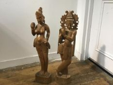 A pair of Indonesian carved teak wood figures of Godesses (h.70cm)