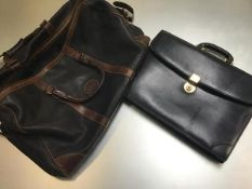 A leather weatherproof genuine Eddie Bauer Canadian leather weekender bag, complete with strap (