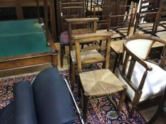 A pair of 19thc church chairs in stained beech with rush seats and a 19thc elm triple spindle back