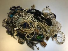 A large collection of costume jewellery including guard chain, 9ct gold studs, paste pearls,