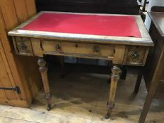 An Edwardian oak writing table, the rectangular top with inset vinyl skiver above a centre frieze