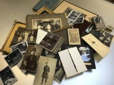 A collection of photographs including a 19thc Reverend and his family, 1920s photographs, school