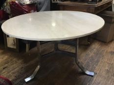 Possibly Johanson Design, Sweden, a dining table with circular travertine top on chromium m plated