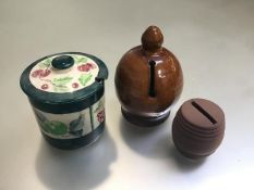 A pottery money bank, a pottery money bank barrel and a handpainted pottery jam dish and cover