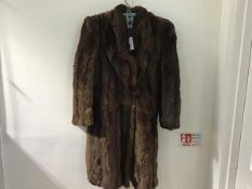 A lady's 1930s vintage three quarter length fur coat with raised collar and single button, with