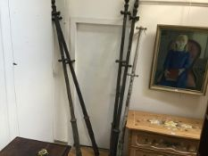 A set of five 19thc cast iron clothes poles with tulip style finials (tallest: 241cm) (two missing