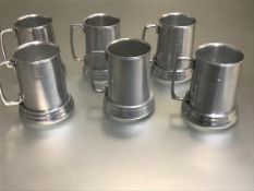 A set of six aluminium American Playboy Bunny engraved tankards with glass bases (h.12cm d.9cm)