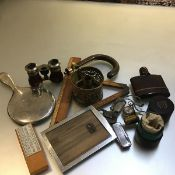 A collection including a brass chamber candlestick, two rules, a plated mirror, a penknife, a pocket