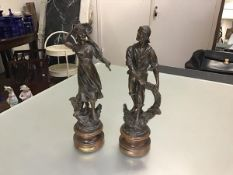 A pair of 19thc bronzed spelter figures, Pecheur and Pecheuse, raised on turned bases (h.39cm,