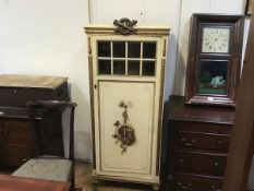A late 19thc French partial gilt side cabinet with flaming torch surmount and glazed inset panel