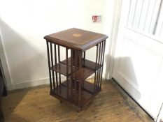 A reproduction Edwardian style mahogany revolving bookcase with satinwood inlaid moulded square top,