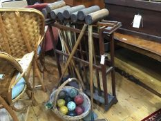 An Edwardian pine croquet mallet stand complete with ten various mallets, metal hoops and a basket