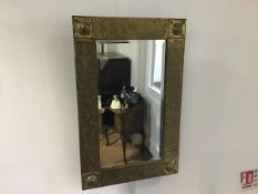 A brass rectangular wall mirror, with bevelled glass plate and stylised hammered diamond finish (