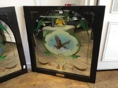 An arched reverse painted pub mirror with daffodil and scroll leaf cartouches, of a golden eagle,