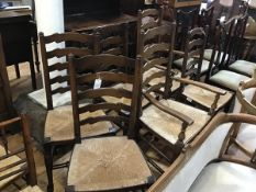 An oak gateleg drop leaf dining table and set of four plus two ladderback rush seat dining chairs,