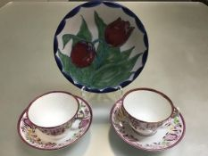 A Highland Stoneware decorated tulip plate (d.20cm) and a pair of 19thc gaudy lustre cups and