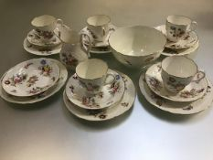 A 1950s Coalport nineteen piece tea service decorated with handpainted floral sprays, with