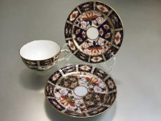 A Royal Crown Derby pattern 2451, Imari coffee can, saucer and side plate (12cm)