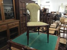 A stained upholstered panel back Edwardian open armchair with inset seat, on tapered supports (h.