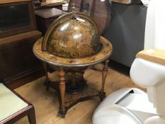 A modern novelty terrestrial style globe with hinged lift up top enclosing a mini bar fitted