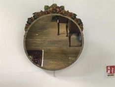 A 1930s barbola circular wall mirror with rose and leaf floral surmount and bevelled glass plate (