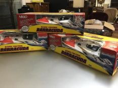 Three Barracuda radio controlled Drambuie on Ice fully functioning speedboats complete with original