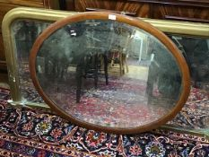 A Victorian mahogany inlaid oval wall mirror with bevelled glass plate (74cm x 94cm)