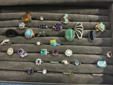 A collection of white metal paste and semi precious stone mounted rings including turquoise,