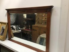 A yew wood wall mirror, the rectangular moulded top above a brass mounted frieze with rectangular