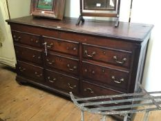 A George III mahogany crossbanded oak mule chest, the hinged rectangular top with moulded edge