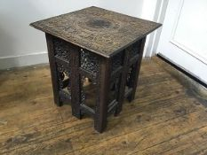 An Eastern hardwood square top table with folding pierced sides and relief carved top (losses) (h.