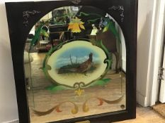 A mahogany framed pub mirror, with stylised daffodil reverse painted cartouche, with pheasant,