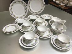 A late 19thc Continental thirty piece teaset with violet and leaf decoration complete with cups,