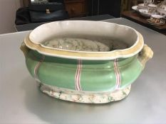 An English china foot bath of scalloped form with twin handles to side with faux marble decorated