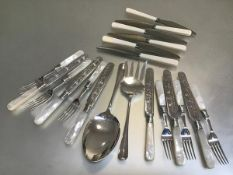 Six pairs of Epns engraved fruit knives and forks, a pair of servers and a set of six stainless