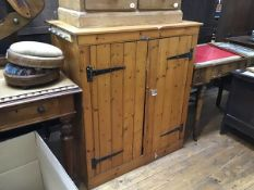 A 19thc stripped pine tongue and groove twin panel door cabinet, the top with moulded edge, raised