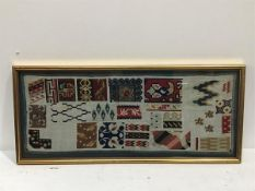 A 19thc sewn work panel demonstrating embroidery stitches and design, in gilt glazed frame (23cm x