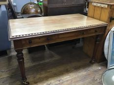 A Victorian oak library table, the rectangular top with moulded and carved edge above two frieze