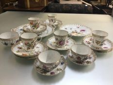 A Dresden china sixteen piece tea service with fluted spiral tapered cups and lobed saucers, a