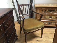 A 19thc oak mahogany spar back open arm carver chair with upholstered seat, on ring turned tapered
