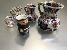 A set of four Masons Ironstone octagonal Imari decorated jugs with dragon scroll handles and a
