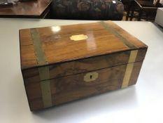 A Victorian walnut brass bound box desk with fitted interior (h.15cm x 35cm x22cm)