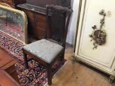 A George III elm country chair with ribbon style top and pierced splat back, with slip in seat, on