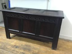 A late 17thc/early 18thc oak three panel coffer, with arcaded frieze between chanelled stiles,