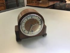 A Davall 1920s oak eight day mantle clock with arched cased and silvered dial with roman numerals